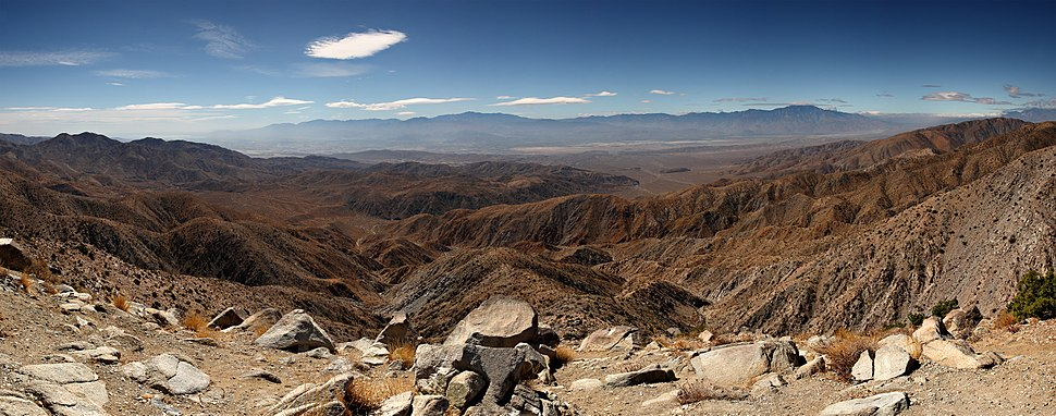 Panorama of the view south from the popular Keys View in the Little San Bernardino Mountains, Joshua Tree National Park, California. Visible landmarks are the Salton Sea (230ft or 70m below sea level) at rear left, along towards the center the Santa Rosa Mountains behind Indio and the San Jacinto Mountains behind Palm Springs. In the valley floor, the San Andreas Fault is clearly visible. At the rear right is the 11,500ft (3,500m) San Gorgonio Mountain.