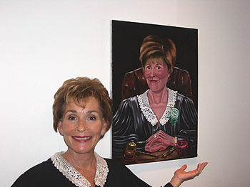 Photo of Judge Judy next to an 18 x 24 oil por...