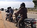 Jugaad technology (A motorcycle pulling another one by a rope).jpg