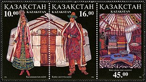Kazakh stamps featuring a traditional bride's dress, groom's clothing and the interior of a kiyiz uy, a traditional Kazakh yurt.