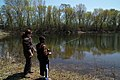 Kid Fishes with Help from Laura Bonneau, Visitor Services Manager at MN Valley NWR. (8740181535).jpg
