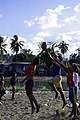 Kids jump for the football at the Lord Howe settlement football training, Honiara. (10706681864).jpg