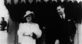 King George V, and his wife Elizabeth, the Queen Mum, at Kitchener Station, 1939-06-06.png