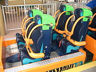 Empty coaster seats, with restraints in place