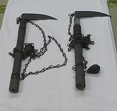 <i>Kusarigama</i> traditional Japanese weapon that consists of a kama (Japanese sickle) on a kusari-fundo (a type of metal chain with a heavy iron weight at the end)