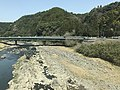 Kusugawa River and Sakaibashi Bridge from train of Kyudai Main Line.jpg