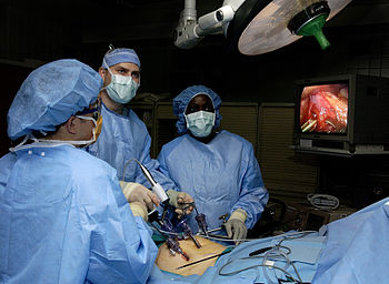 Physicians perform laparoscopic stomach surger...