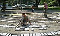 Laying labyrinth pavers South Congregationalist Church Main Street downtown Saint Johnsbury VT August 2017.jpg