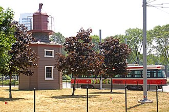 Fort York (neighbourhood) - A streetcar passes by the Queen's Wharf Lighthouse. Fort York neighbourhood is served by 509 Harbourfront streetcar line.