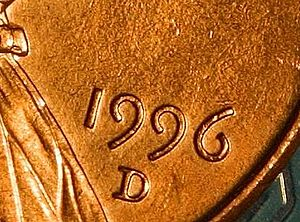 Detail of hanging numerals on a Lincoln penny