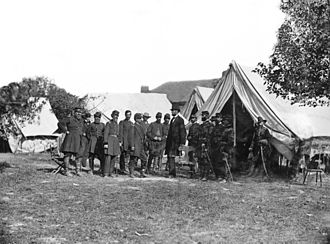 Battle of Antietam - Lincoln with McClellan and staff at the Grove Farm after the battle. Notable figures (from left) are 1. Col. Delos Sackett; 4. Gen. George W. Morell; 5. Alexander S. Webb, Chief of Staff, V Corps; 6. McClellan;. 8. Dr. Jonathan Letterman; 10. Lincoln; 11. Henry J. Hunt; 12. Fitz John Porter; 15. Andrew A. Humphreys; 16. Capt. George Armstrong Custer.