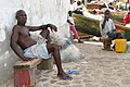 Locals Outside the Door of No Return - Cape Coast Castle - Cape Coast - Ghana (4720988327).jpg