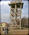 Lou and Hameed lowering equipment from water tower (5526449476).jpg