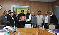 M.M. Pallam Raju being presented a Report on a single legislation for central universities, in New Delhi. The Minister of State for Human Resource Development, Dr. Shashi Tharoor, the Secretary (Higher Education).jpg