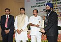 M. Veerappa Moily presenting the 8th National ICWAI Award for Excellence in Cost Management-2010, in New Delhi. The Minister of State for Petroleum and Natural Gas and Corporate Affairs, Shri R.P.N. Singh is also seen.jpg