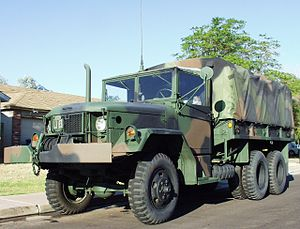 M35 series 2½-ton 6x6 cargo truck - AM General M35A2 with winch and camouflage cargo cover