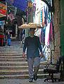Man carrying bread on head in Old City, Jerusalem.jpg