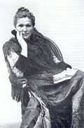 Marie Lang in chair.jpg
