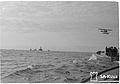 Marine pilots approach a ship convoy led by an escort plane outside Kobba Klintar, Mariehamn, Åland in 1942.jpg