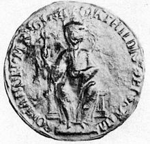 Seal image of a seated figure circled by writing.