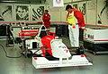 Mclaren MP4-10B - Mark Blundell in the pit garage at the 1995 British GP, Silverstone (49713027788).jpg