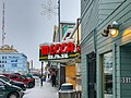 Mecca Bar in Snow, Downtown Fairbanks, Alaska (44493336605).jpg