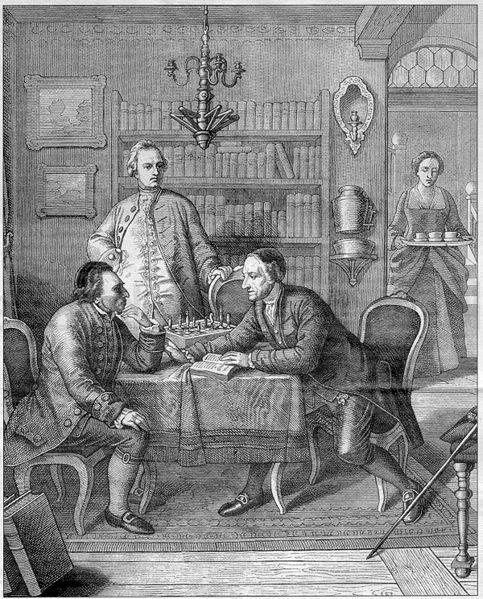 Pen and ink drawing of three men, two sitting and one standing, around a table deep in discussion.  A woman in the background is bringing beverages for the men.
