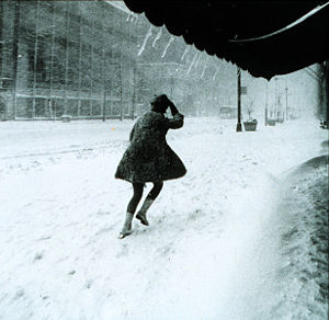 A resident struggles to walk in a blizzard in ...