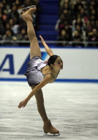 Mirai Nagasu - Nagasu performs an arabesque spiral during her short program City Lights at the 2008 NHK Trophy.