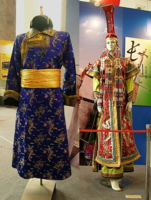 Deel (clothing) - Mongolian deels for a man (left) and a woman (right)