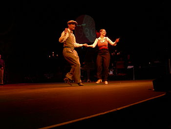 Peter Loggins and Mia Goldsmith swing dancing ...