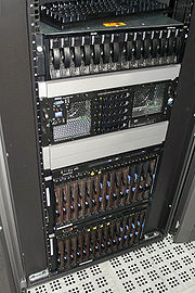 "The Opera Community rack. From the top, user file storage (content of files.myopera.com), ""bigma"" (the master MySQL database server), and two IBM blade centers containing multi-purpose machines (Apache front ends, Apache back ends, slave MySQL database servers, load balancers, file servers, cache servers and sync masters)."
