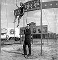 NBC-TV host Charles Van Doren with trapeze artist Delia Cristiani.jpg