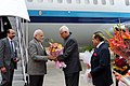 Narendra Modi being received by the Governor of Jammu and Kashmir, Shri N.N. Vohra, on his arrival at Jammu airport, in Jammu and Kashmir. The Minister of State for Development of North Eastern Region (IC).jpg