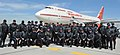Narendra Modi in a group photo with the motor cycle riders of Canada Police at the time of PM's departure from Toronto, in Canada on April 16, 2015. The Prime Minister of Canada, Mr. Stephen Harper is also seen.jpg