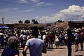 Native Americans standing in a crowd around adobe buildings. (1cf31df47dba4121af67baac6dab2c3a).jpg