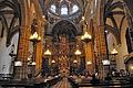 Nave central y altar mayor de la basílica del Real Monasterio de Santa María de Guadalupe.JPG