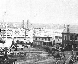 New London, Connecticut - The Parade in 1883, with a railroad station built in 1864 at right (replaced by New London Union Station in 1887) and ferryboats in the river