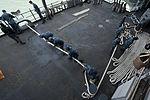 Nimitz sailors heave a line 130513-N-LP801-067.jpg