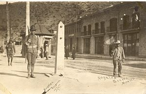 Battle of Ambos Nogales - American and Mexican soldiers guarding International Street in Ambos Nogales: The obelisk in the center is a border marker, which still stands. A Mexican border post is in the middle foreground of the image. The Americans had a similar one on their side.