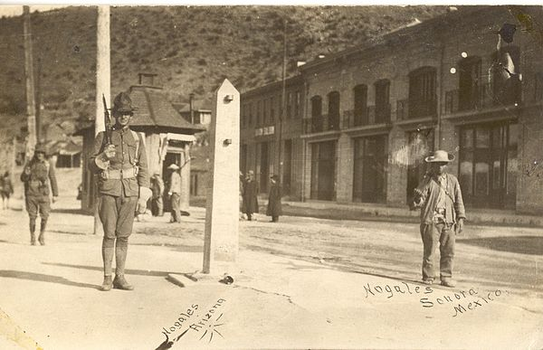 American and Mexican soldiers guarding International Street in Ambos Nogales. The obelisk in the center is a border marker, which still stands. A Mexican border post is in the middle foreground of the image. The Americans had a similar one on their side. Nogales Arizona 1910-1920.jpg