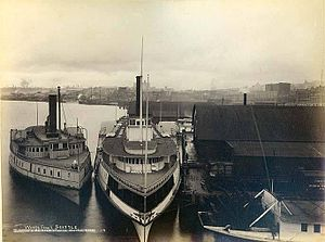 T. J. Potter - T.J. Potter in center, with smaller sidewheel steamer North Pacific on left, at Seattle, Washington, 1891