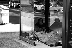 Affordable housing in Canada - Homeless man living in a bus shelter in downtown Toronto (2010)