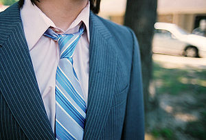 A torso and striped necktie.