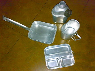 Mess kit - Open mess kit contains skillet, food tray, canteen and cup