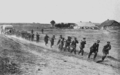 PSM V88 D072 German soldiers pulling trucks through mud in the eastern front 1916.png