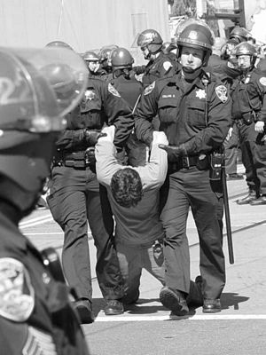 Pacifism - Anti-war activist arrested in San Francisco during the March 2003 protests against the war in Iraq