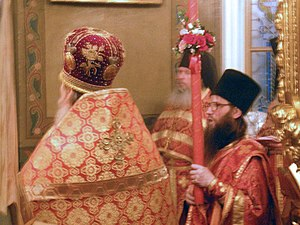 Paschal trikirion - Russian Orthodox deacon holding a red paschal deacon's candle