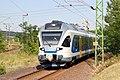 Passenger train arriving at Vacratot Station (34275685753).jpg