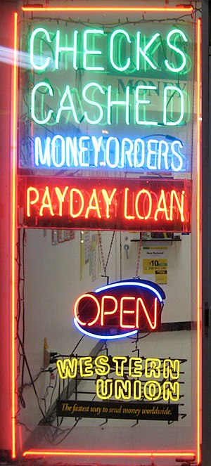 Payday loans in the United States - A shop window in Falls Church, Virginia advertises payday loans.